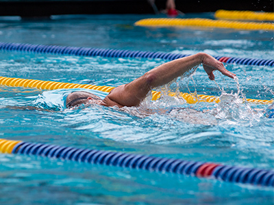 man swimming at spieker pool
