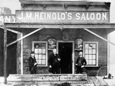 Black and White photo of J.M. Heinold's Saloon in 1885