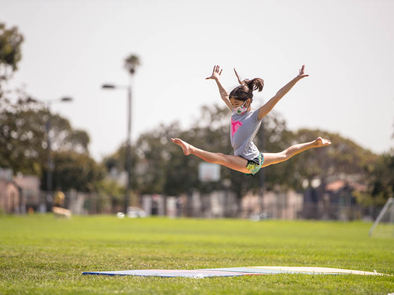 gymnast leaping at golden bear reacreation center field